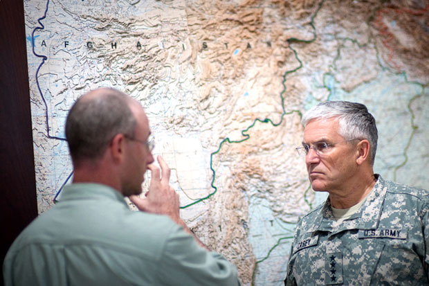 U.S. Army Chief of Staff, Gen. George W. Casey Jr., (right) plots colonial domination of Afghanistan in bunker in Kabul